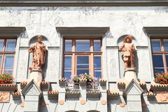 Statues on renaissance house Stock Images