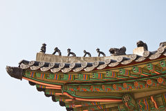 Statues on the roof. The placement of the pattern tiles Stock Image