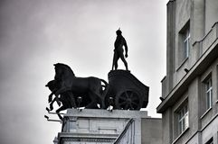 Statues on roof of Banco Bilbao Vizcaya Madrid Spain Stock Image