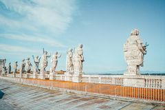 Back view of eleven statues of the saints apostles on the top of St Peter Basilica roof,Vatican City, Rome, Italy Royalty Free Stock Photos