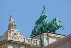 Statues on roof of Museum of Ethnography in Budapest, Hungary. BUDAPEST, HUNGARY - JUNE 14, 2016: Statues on roof of Museum of Ethnography in Budapest, Hungary Royalty Free Stock Photography