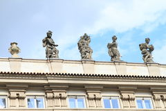 Statues on roof. In Prague (Czech Republic) covered with net against pigeons Stock Images