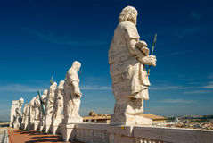 Statues on the roof of St. Peter`s basilica Stock Image