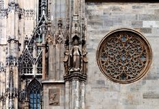Statues and rose on the St. Stephen's Cathedral. Rose window, maiden statue and other details of the famous cathedral of saint Stephan, Vienna, Austria Royalty Free Stock Photography