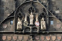 The statues of saints and kings at the Bridge Tower of Charles B Stock Photography