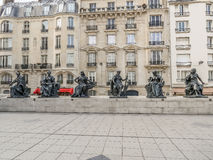 Statues of six continets in front of d`Orsay Museum Stock Image