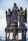 Statues St. Francis Seraphic or St. Francis of Assisi, father of mendicant orders, with two seraphims, guardian angels on the Char Stock Photos