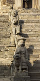 Statues on the steps of an ancient temple in Bhaktapur, Nepal Royalty Free Stock Images