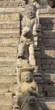 Statues on the steps of an ancient temple in Bhaktapur, Nepal Stock Photography