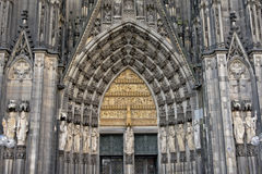 Statues and stone carving above the entrance of the Catholic cathedral of Cologne. Detail of Roman Catholic cathedral of Cologne or High Cathedral of Saint Peter stock photography