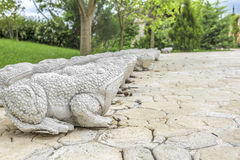 Statues of stone frogs. Royalty Free Stock Photo