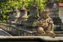 Statues and stupas of Mendut temple Stock Photos
