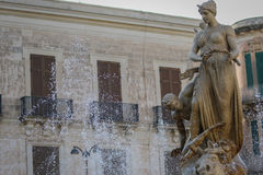 The statues of Syracuse. The statues of the fountain in the square in Syracuse Stock Image
