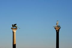 Statues on tall columns Royalty Free Stock Image
