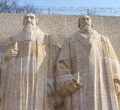 Statues of Theodore de Beze and John Knox. Royalty Free Stock Photos