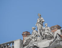 Statues of three women, goddesses on the roof Russow Royalty Free Stock Image