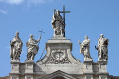 Statues on the top of Saint John Lateran Basilica Royalty Free Stock Photo