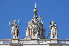 Statues on the top of Saint Peter Basilica facade Stock Photos