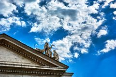 Statues on top of the Tuscan colonnades. VATICAN CITY, VATICAN - MAY 17, 2017: Some of the statues on top of the Tuscan colonnades in Saint Peter's square in Royalty Free Stock Photography