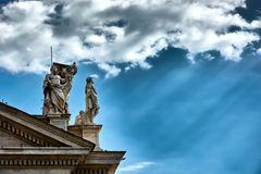 Statues on top of the Tuscan colonnades. VATICAN CITY, VATICAN - MAY 17, 2017: Some of the statues on top of the Tuscan colonnades in Saint Peter's square in Royalty Free Stock Images