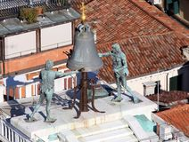 Statues of tow mooors of the clock tower  in venice Stock Photo
