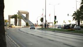 Statues and traffic at afternoon. Karsiyaka - Izmir TURKEY stock video footage