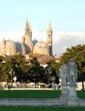 Statues and trees in the island Memmia Prato della Valle and the Basilica del Santo in Padua in Veneto (Italy) Royalty Free Stock Photos