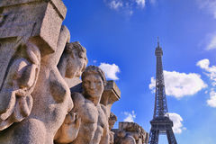 Statues of The Trocadero in front of the Eiffel Tower. PARIS - MAR 2: Statues of The Trocadero in front of the Eiffel Tower on March 2, 2014 in Paris, France Royalty Free Stock Photos