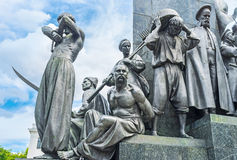 The statues of Ukrainian serfs. The statues of Ukrainian peasants -serfs around the monument to the famous poet, writer and freedom fighter - Taras Shevchenko Stock Photo