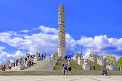 Statues in Vigeland park in Oslo centerpiece and sky Royalty Free Stock Image