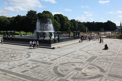 Statues in Vigeland park in Oslo, Norway. OSLO, NORWAY- JULE 26: Statues in Vigeland park in Oslo, Norway on Jule 26, 2012. The park covers 80 acres and features Stock Image