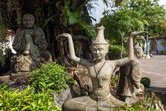 Statues at the Wat Pho temple in Bangkok. Three statues at the Wat Pho Po temple complex in Bangkok, Thailand stock image