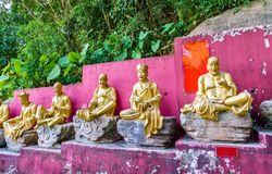 Statues on the way to the Ten Thousand Buddhas Monastery in Hong Kong stock photo