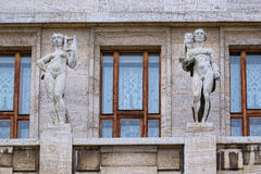 Statues between the windows Stock Images