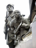 Statues of a woman and a man with rifles. A fragment of a Russian revolution/civil war  monument  in Samara, Russia Stock Photography