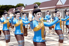 Statues of women dancers in the procession of Boon Bang Fai bamboo rocket Festival, Yasothon, Thailand. Yasothon, Thailand - May 2017: Statues of women dancers Royalty Free Stock Image