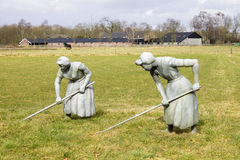 Statues of women engaged in agriculture Stock Photo