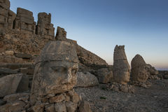 Statues of Zeus left, Antichos and Hercules on the eastern platform at Mt Nemrut in Turkey at sunrise. Royalty Free Stock Images