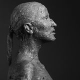Statuesque woman in clay royalty free stock photo