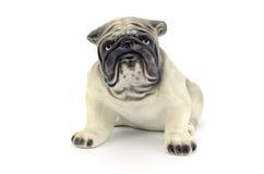 Statuetta del cane isolata su fondo bianco Immagine Stock Libera da Diritti