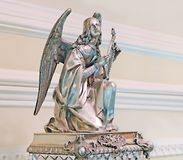 Statuette of an angel and other retro things are standing on a wooden table. royalty free stock photos