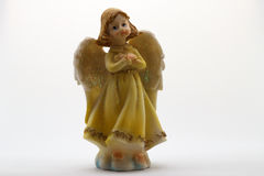 Statuette of an angel. On white background Royalty Free Stock Image