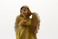 Statuette of an angel. On white background Royalty Free Stock Photos