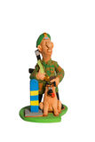 Statuette of border guard with a dog Royalty Free Stock Photography