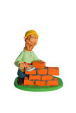 Statuette of a bricklayer Royalty Free Stock Photography