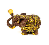 Statuette of brown elephant with yellow sapphire isolated on a white background. Photo of statuette of brown elephant with yellow sapphire isolated on a white stock image