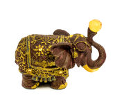 Statuette of brown elephant with yellow sapphire isolated on a white background. Photo of statuette of brown elephant with yellow sapphire isolated on a white stock images