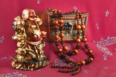 Statuette of Buddha, casket, beads made of wood Stock Images
