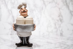 Statuette of a Cook with Shakers Royalty Free Stock Photos