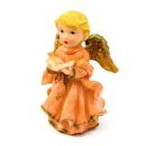 Statuette d'ange de porcelaine avec le livre d'isolement sur le fond blanc Image stock